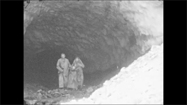 1920s: Family walks in and out of ice cavern.