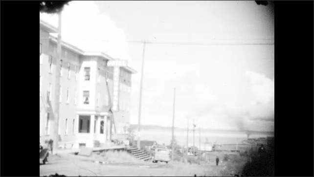 1920s: Three-story buildings and hotel in city.
