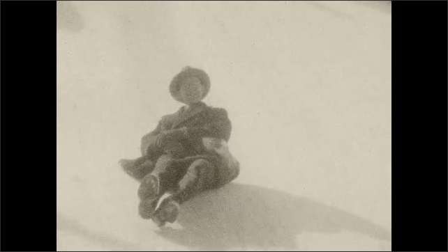 1930s: A man sits on the ice, slides down. Two women climb up a mound of ice. Man sits and slides down on the ice. Group of people line up, smile and pose.