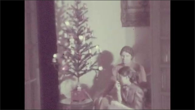 1930s: UNITED STATES: lady and child sit on stair by tree. Girls come down stairs.