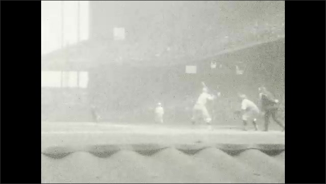 1930s: UNITED STATES: baseball players on pitch. Players return to bench. Player with bat.