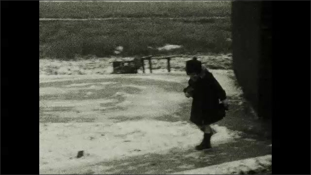 1920s: UNITED STATES: man climbs through window of car. Girl walks in snow. Man carries baby in snow.