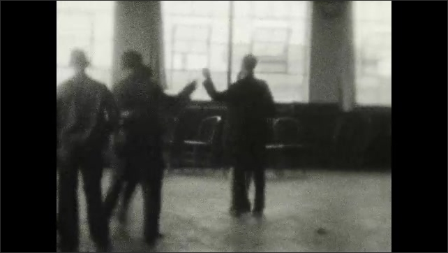 1920s: UNITED STATES: couples dance in hall. Ladies dance together in pairs. Dance in hall.