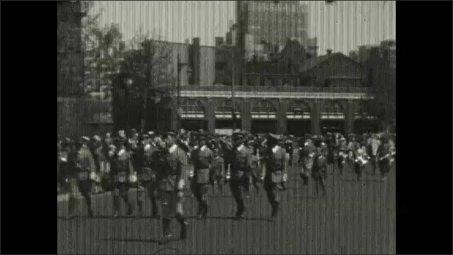 1930s: men in uniform marching in parade, marching band in parade