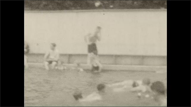 1920s: People dive off high dive. Women swims in pool with girl. People swim in pool.