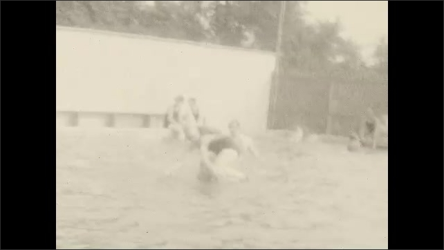1920s: People dive into pool.