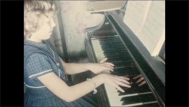 1950s: Girl stands next to burning tree.  Little girl plays piano.