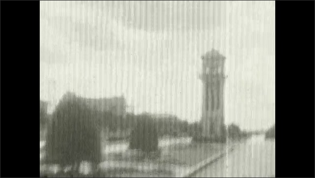 1920s: UNITED STATES: stone building. View along road from car. River bed. Sightseeing trip by car.