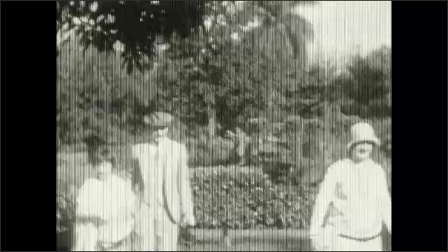 1920s: UNITED STATES: ladies stand outdoors. Man with girl. Tourists go sightseeing.