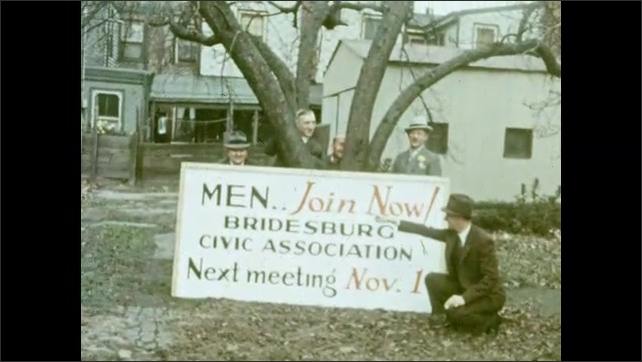 "1920s: Men pose under tree, point to sign: ""Men.. Join Now! Bridesburg Civic Association, Next Meeting Nov. 1."""