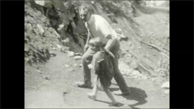 1920s: Girl. Mountain, lake, canoes at dock. Man and girl, girl kisses man on cheek. Man and girl hike up mountain. Man and woman and girl sit on bench, girl drinks from mug.