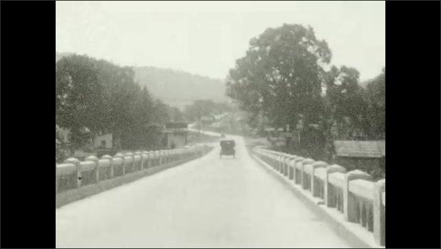 1920s: Lake and dam. Bridge. Car drives over bridge. Sign for North Umpqua River. River and dam.