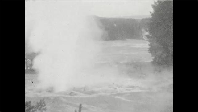 1920s: UNITED STATES: Minute Man Geyser sign. Geyser pumps spray. Steam over geyser. Lady walks by geyser. Beryl Spring sign.