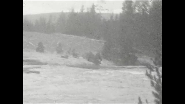 1920s: UNITED STATES: Lady and girl by geyser. Steam above geothermal pool. Steaming river. Bridge across water