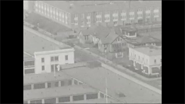1920s: UNITED STATES: choir sing outdoors at memorial event. View across roofs of buildings. Buildings in Washington DC