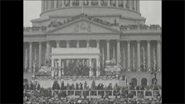 1920s: UNITED STATES: buildings in Washington DC. People attend large event.