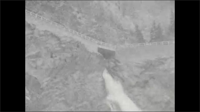1930s: Mountain.  Waterfall.  Rushing river.