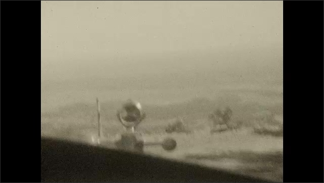 1930s: UNITED STATES: view of road from car windscreen. Mountain road journey. Road trip in mountains.