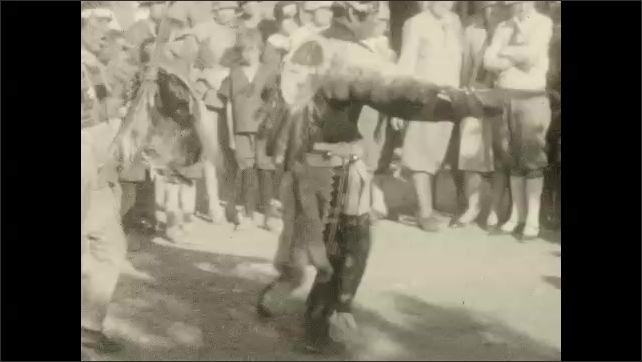 1930s: UNITED STATES: Indians perform dance and music for Hermits Rest guests.