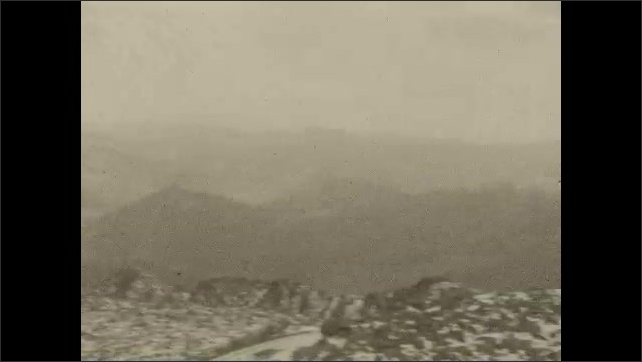 1930s: UNITED STATES: building on mountain. View across mountains. View from mountain summit.