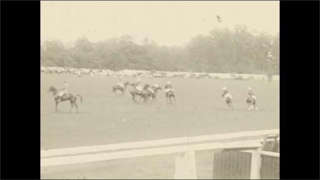 1930s: Polo match.  Spectators.