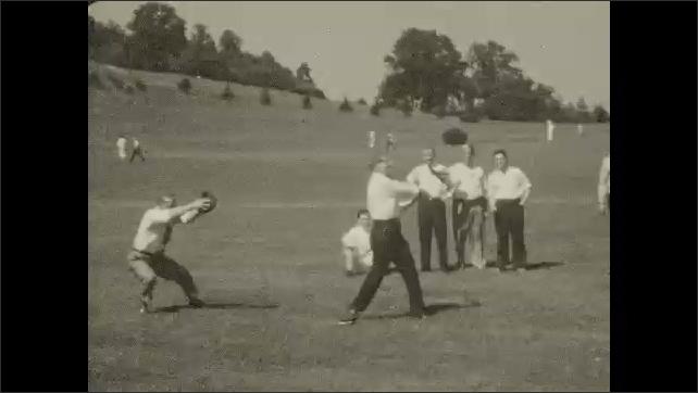 1930s: Men play baseball.  Men swing bat.  Man runs.