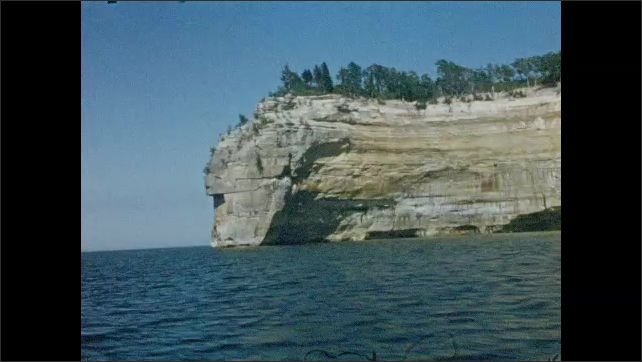 1950s: UNITED STATES & CANADA: view of cliffs from boat. Sea Queen boat cruise to Pictured Rocks.