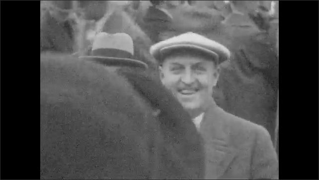1920s: Traveling on boat passed bridges and small islands. Tourists climb aboard docked boat. Boating passed small islands. Men on smiling. Firefighters fight fire in building as crowd watches.