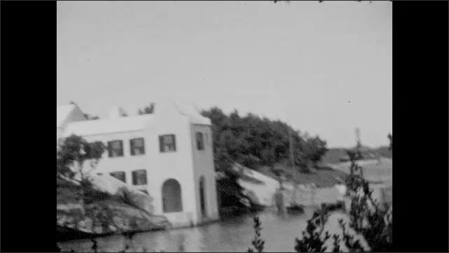 1930s: Horses pull carriage.  Church.  Water.  Shore.