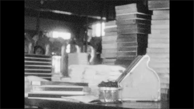 1920s: Women in factory package up hosiery. Packages of hosiery.