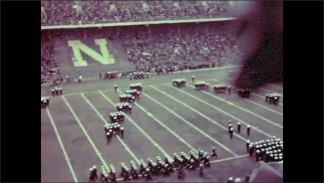 1930s: Baseball players at the Baker Bowl. Large marching band takes football field at packed stadium.