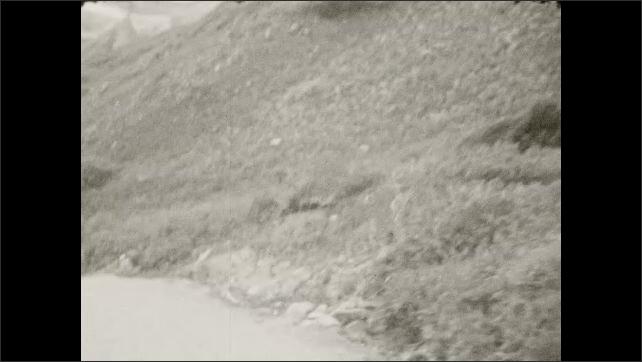 1930s: Mountain road. Mountains.