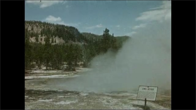 1940s: UNITED STATES: hot springs and geyser. Sapphire Pool erupts. Smoke above pool