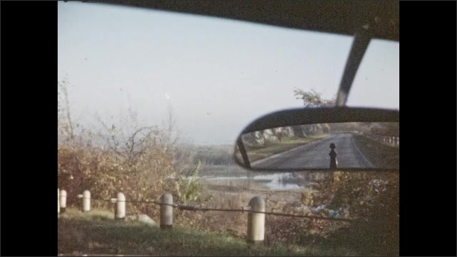 1940s: UNITED STATES: Carvings in rocks. View from car windscreen. View from inside car