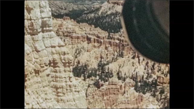 1940s: Wind blows purple sage on the ground. Rock formations and hoodoos. View of Bryce Canyon.