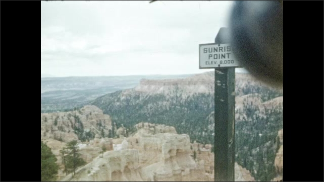 1940s: Bryce Canyon. Sign ????unrise Point Elev. 8,000????with view of Bryce Canyon. Rock formations.