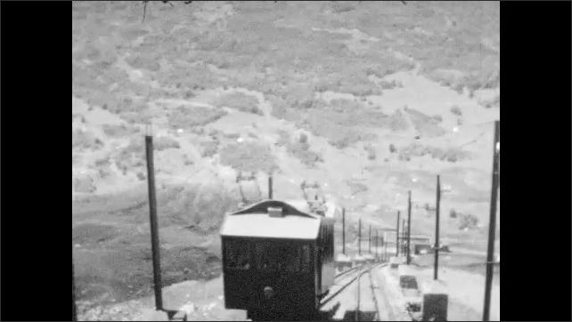 1930s: ITALY: EUROPE: train to top of mountain. Mount Vesuvius visit. Excavations at Herculanum.