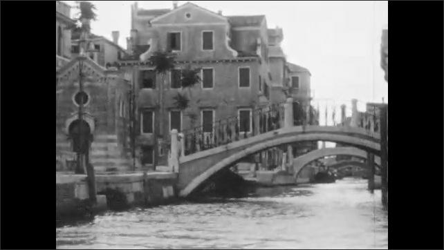 1920s: Murals on Salviati Palazzo. Bridges over canal. Gondolas and villas.
