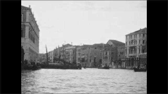 1920's: View of Rialto Bridge on the Venice Grand Canal. Smaller canals with footbridge.