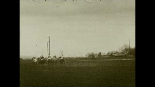 1920s: UNITED STATES: man climbs on horse. Men play polo on horses. Polo match.