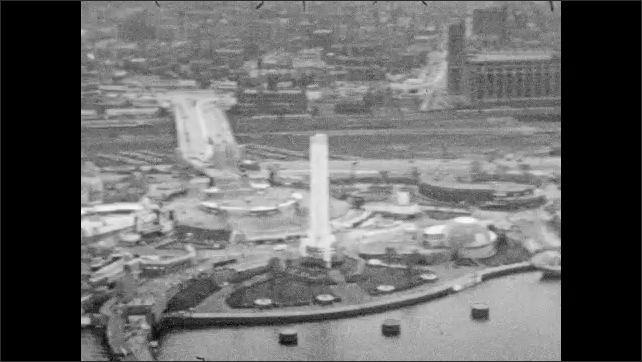 1930s: Panoramic view of Chicago. World's Fair buildings along pier in city. Aerial panorama of Chicago World's Fair. Title placard.