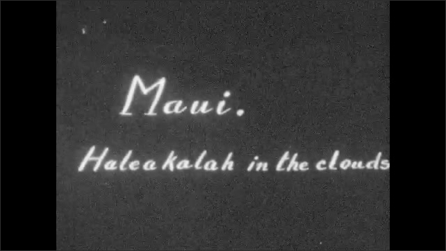 1920s: Fields of pineapple plants. Title card with words. Vast mountain vista.