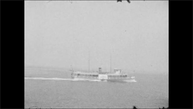 1920s:  UNITED STATES: boats travel aross harbour. Wake behind boat