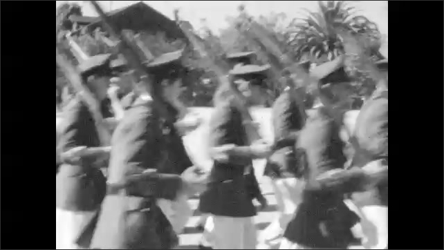 1940s: Military cadets play instruments and march in formation. Cadets carry riffles and march in formation. Young cadets march in formation.