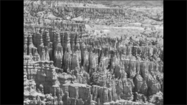 1940s: Vista of rock spires and mountains in Bryce Canyon.