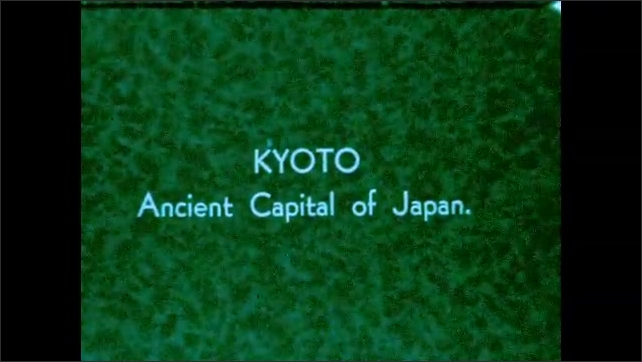 1930s: Woman washes cloth in buck in alley as man enters building. Man stands, stroking facial hair. Title card: Kyoto. Woman prays at altar. Pagoda.