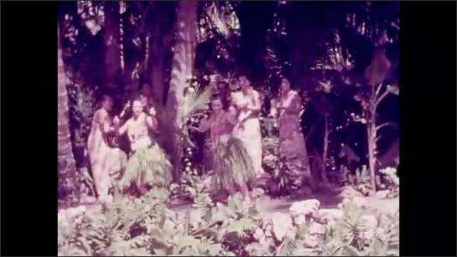 1940s: Hula dancers.  Women play instruments.