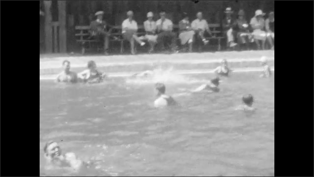 """1940s: People splash and play in pool.  People sit on park benches.  Sign reads """"FOOT OF YOSEMITE FALLS."""""""