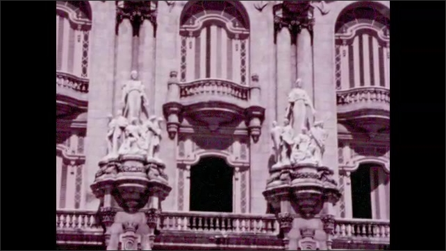 1940s: Exterior of Grand Theater of Havana. Statuary and decorative details on outside of theater. Exterior El Capitolio government building.