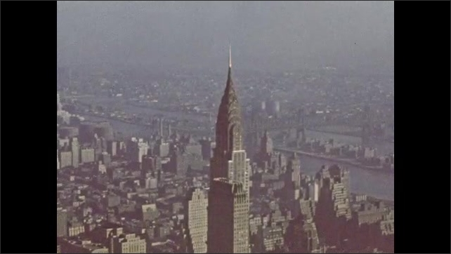 New York City 1940s: view of city from 102nd floor observatory. Factory and smoke by river. Horizon and buildings